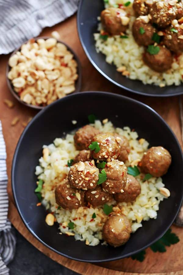 These Slow Cooker Thai Chili Peanut Meatballs take just five minutes to prepare and are the answer to getting dinner on the table quick! Turkey meatballs are simmered in a peanut butter and coconut milk sauce and are delicious served over rice or pasta.