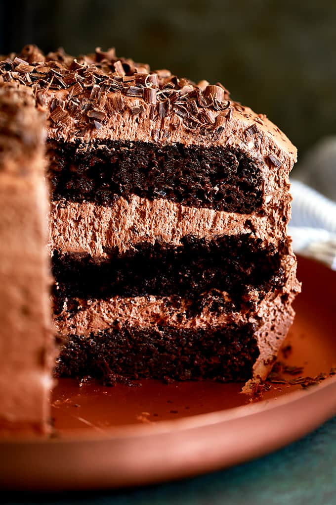 This Triple Layer Chocolate Brownie Cake is for the die-hard chocolate lovers of the world.  Chocolate cake, fudgy brownie, another layer of chocolate cake and it's all covered with the most delicious chocolate buttercream.  Grab an icy cold glass of milk and prepare to enjoy every last bite of this chocolate nirvana.