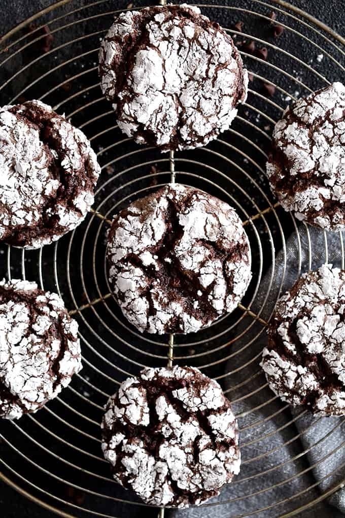 An overhead shot of Double Chocolate Ginger Crinkle Cookies resting on a wire cooling rack.