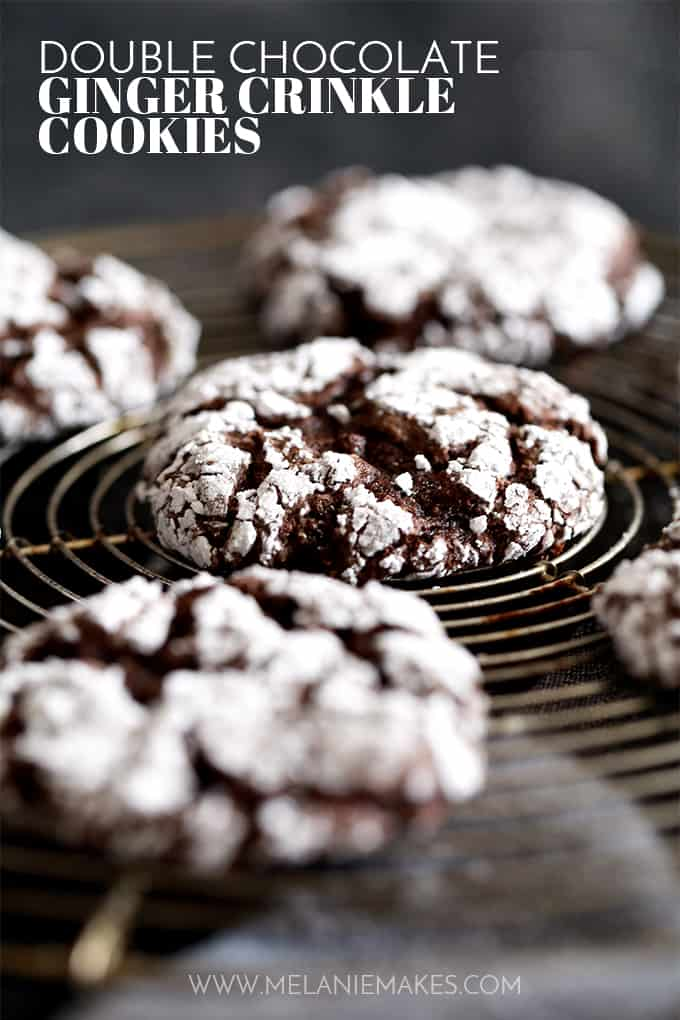 Double Chocolate Ginger Crinkle Cookies rest on a wire cooling rack.