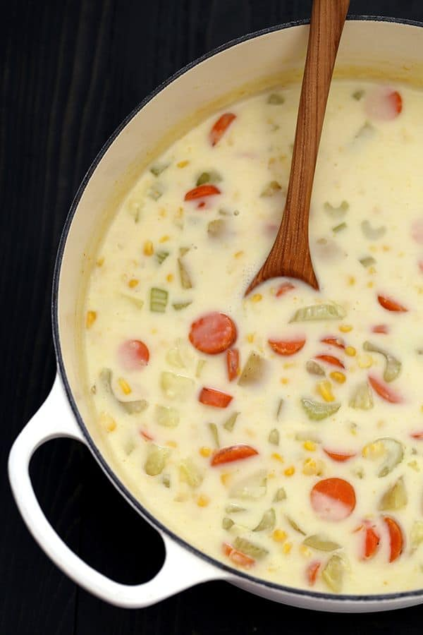 Carrots, potatoes and celery are stirred together with a creamy, comforting rue and corn to create a quick and easy Potato Corn Chowder.  Each bowl is garnished with additional corn, green onions and cheddar cheese to provide a contrast in texture that keeps you returning to your bowl for just one bite.