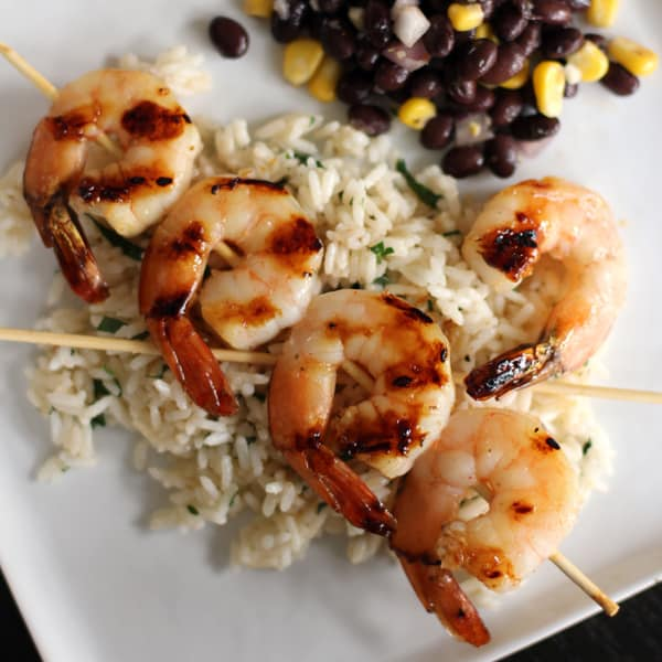 honey lime shrimp skewers with cilantro lime rice and chili lime black bean and corn relish
