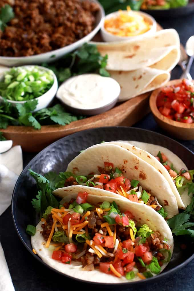 Lentils, brown rice and the usual taco seasoning suspects make up these incredibly easy Slow Cooker Lentil and Brown Rice Tacos.  Simply add all of the ingredients to the slow cooker, stir and walk away.  Dinner will be waiting for you, not the other way around.  This versatile filling is also great as a topping for nachos, on a bed of lettuce for a taco salad and as a filling for quesadillas or burritos.