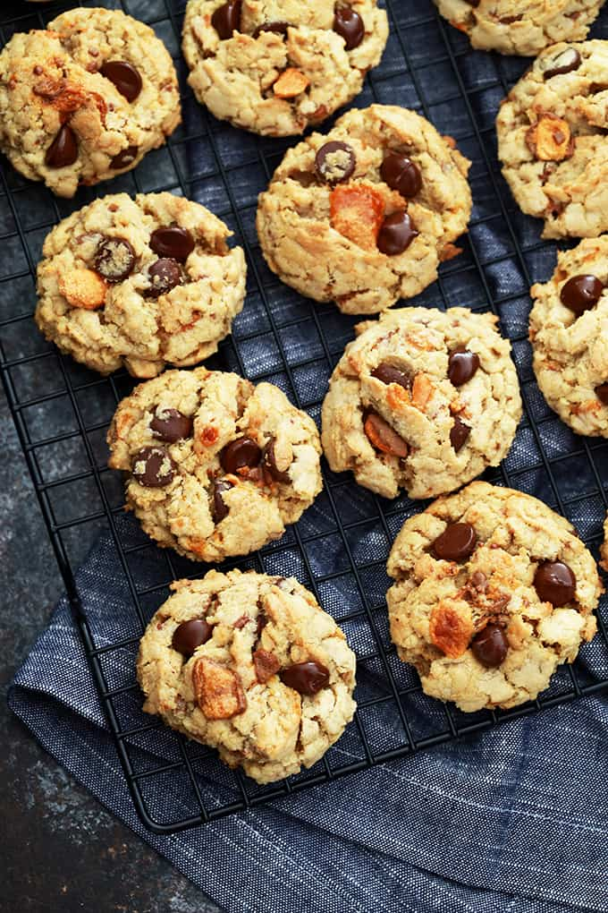 These hearty Butterfinger Oatmeal Chocolate Chip Cookies are a chocolate and candy bar lover's dream. Loaded with oatmeal, chunks of candy bar and studded with chocolate chips, they're a cold glass of milk's perfect companion.
