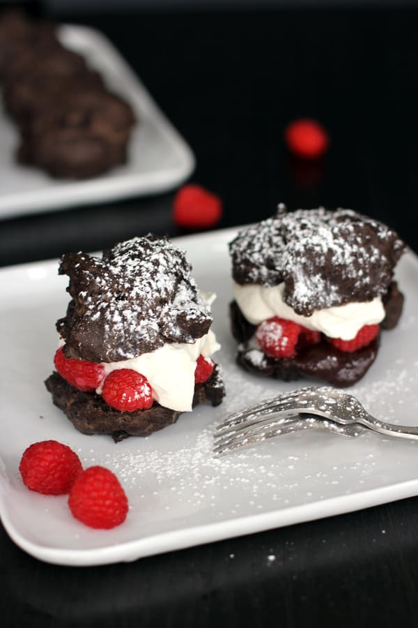 Chocolate Cream Puffs with Honey Rum Whipped Cream, Raspberries and Chocolate Ganache | Melanie Makes melaniemakes.com