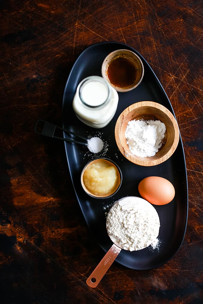 All of the ingredients needed to prepare the Best Buttermilk Pancakes on a black tray.