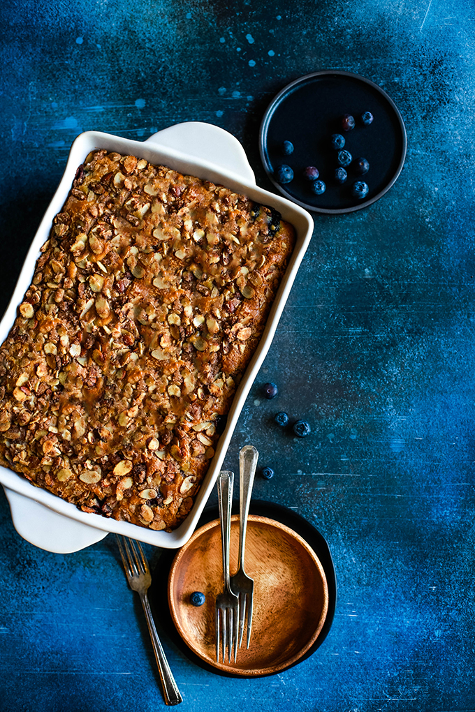 An overhead view of a white casserole dish of Blueberry Lemond Almond Coffee Cake.