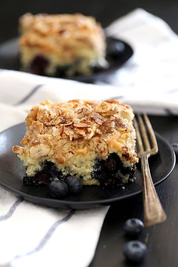 Your search for the perfect coffee cake recipe has ended with this Blueberry Lemon Almond Coffee Cake. A light and fluffy lemon almond cake is studded with fresh blueberries that burst to create pockets of fruity deliciousness and topped with a cinnamon sugar almond crumble that's reminiscent of the cinnamon sugar almonds everyone devours around the winter holiday season.