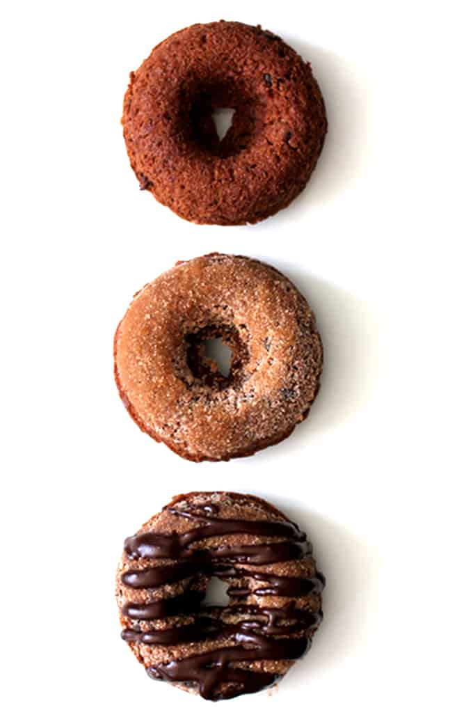 These Triple Chocolate Snickerdoodle Donuts are a perfect treat any time of day!  A dreamy combination of part breakfast treat, part cookie.  A cocoa and cinnamon infused donut studded with chocolate chips, dusted in cinnamon sugar and then drizzled with dark chocolate.