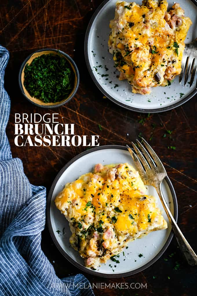 Two plates of Bridge Brunch Casserole with a small bowl of parsley.