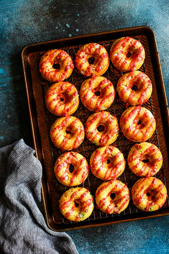 Jelly Bean Donuts on a cooling rack.