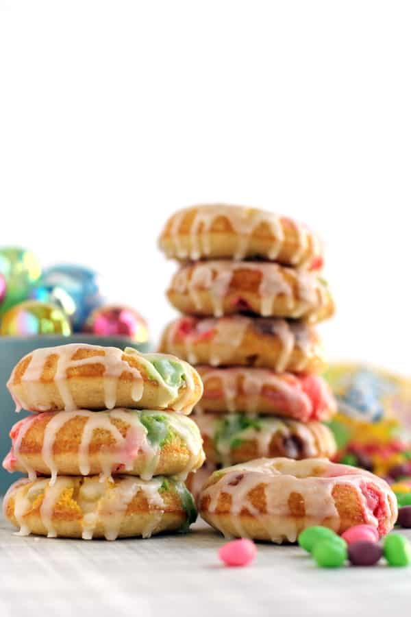 The perfect treat created with candy from your Easter basket stash! These Jelly Bean Donuts are bedazzled with spring colored jelly beans and covered with a vanilla sugar glaze. They're sure to be a hit with anyone with a sweet tooth.