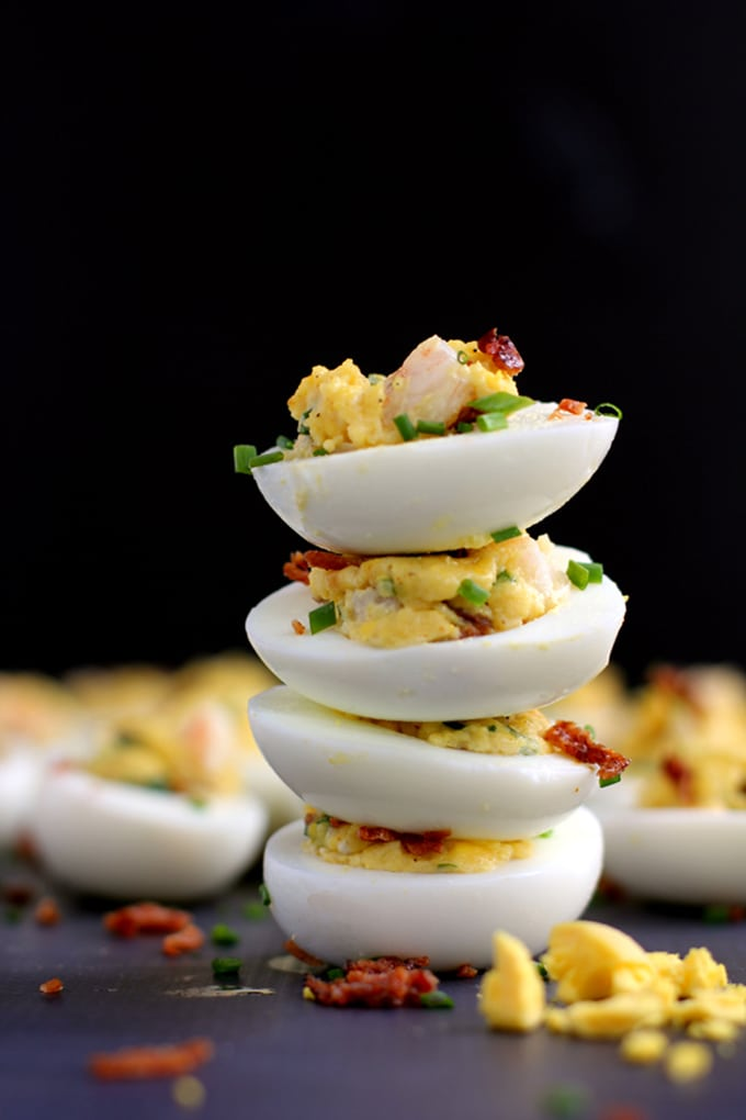 These Shrimp and Bacon Stuffed Deviled Eggs are going to go fast. Double the recipe, my friends. The traditional deviled egg goes upscale with the addition of shrimp and bacon, becoming an instant dinner favorite.
