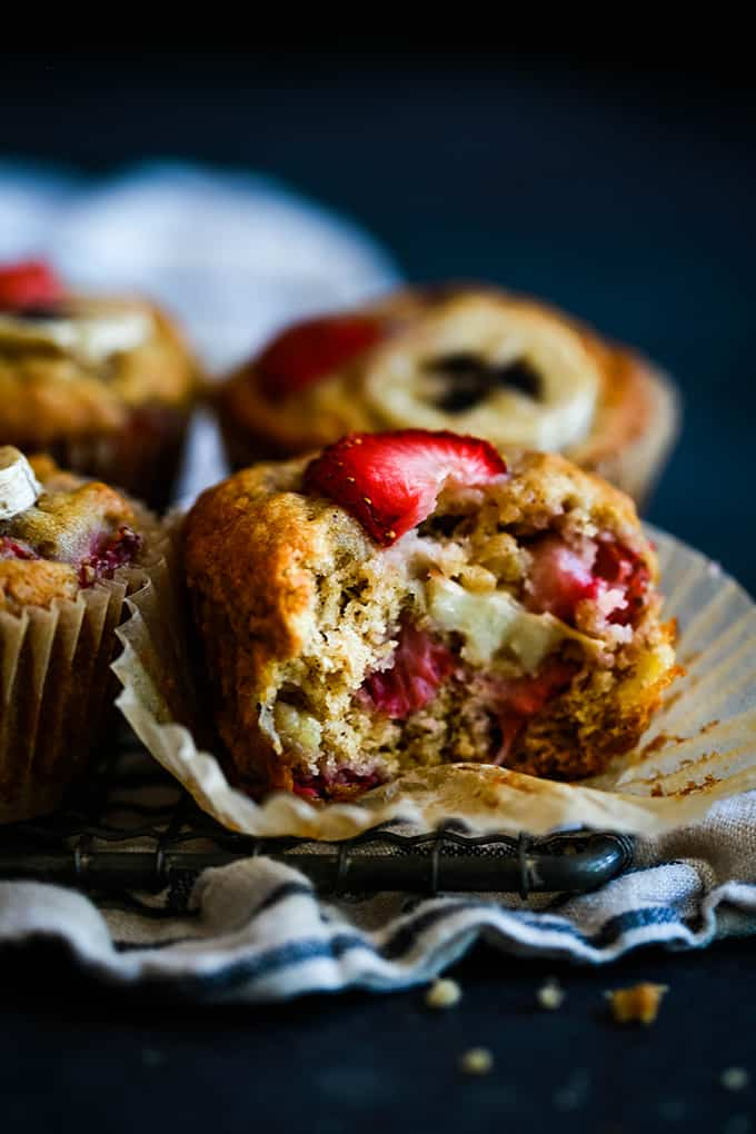 A Strawberry Banana Muffin with a bite removed.