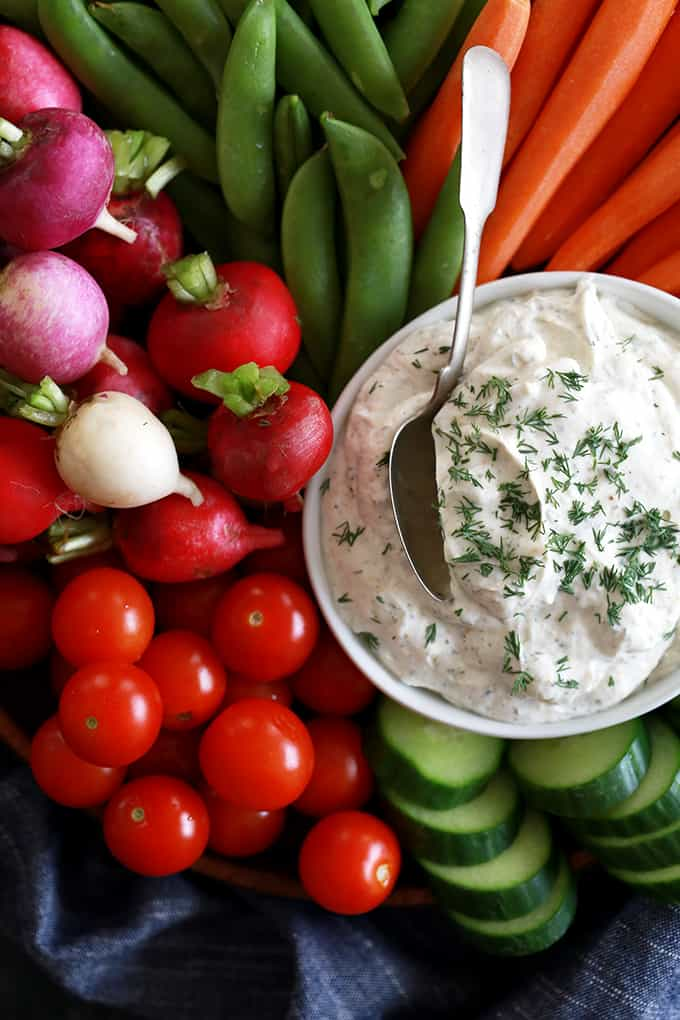A spoon in a bowl of Yogurt Dill Vegetable Dip.