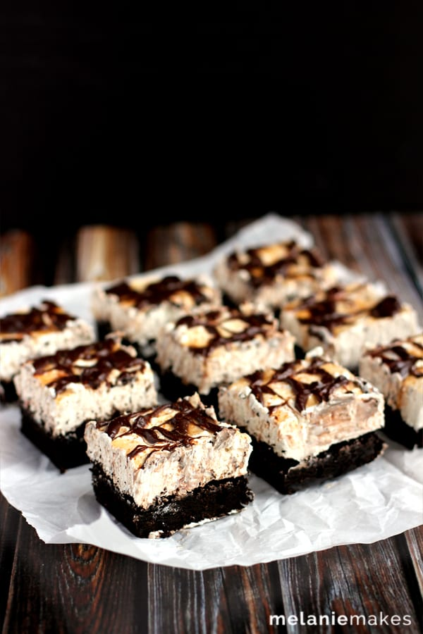 These Snickerdoodle Cheesecake Brownie Bars are the delicious combination of three different desserts. A rich, soft brownie is the base for a cinnamon cheesecake that is then topped with caramel, chocolate ganache and a dusting of cinnamon.