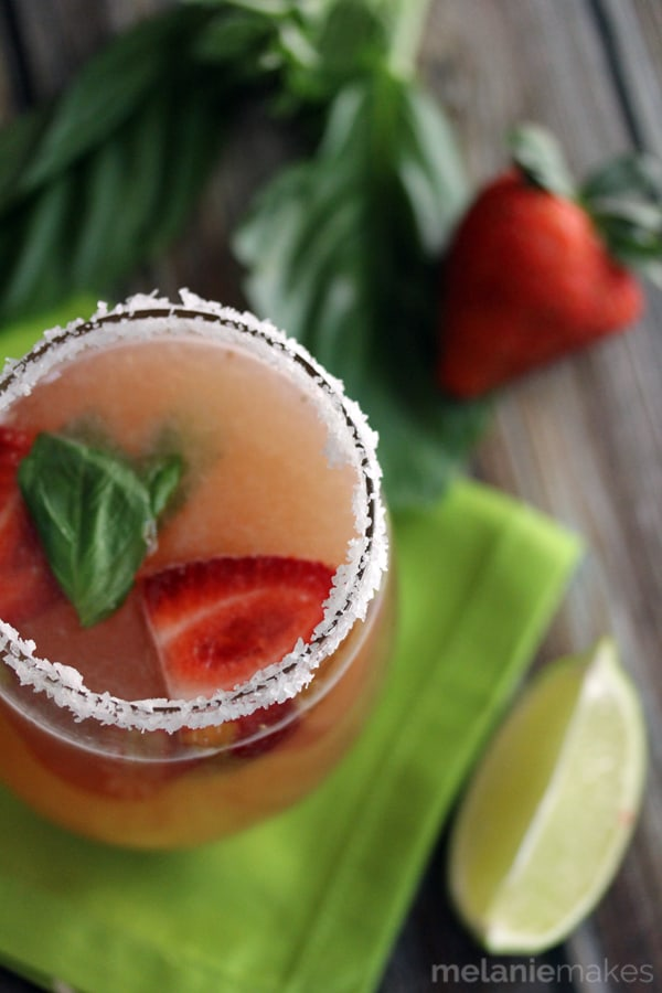Easiest ever?  Absolutely!  With just four ingredients, these Strawberry Basil Margaritas take just minutes to create.  A pitcher and a wooden spoon are the only items necessary to have these delicious drinks at the ready.