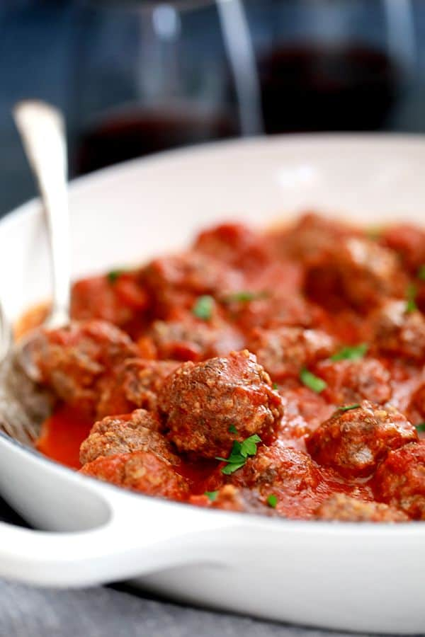 These Easy Baked Meatballs come together in just 10 minutes and then are baked to perfection in the oven. No oil splatters or manning a frying pan required!