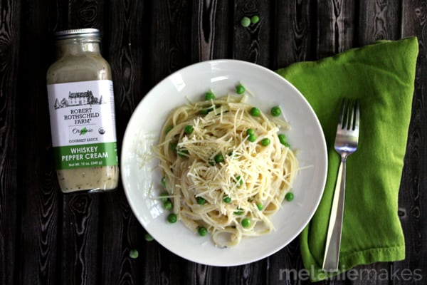 A lightened alfredo sauce that feels absolutely decadent and created with minimal effort.  This Fettuccine and Peas with Whiskey Pepper Cream Sauce is on the table in just 20 minutes.  Perfect for a busy weeknight or special enough for when you want to impress with minimal effort.