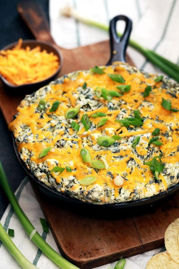 This Creamy Baked Double Cheese and Spinach Dip is the perfect make ahead appetizer.  Cream cheese, yogurt, cheddar cheese, spinach and ranch seasoning are baked to cheesy perfection.