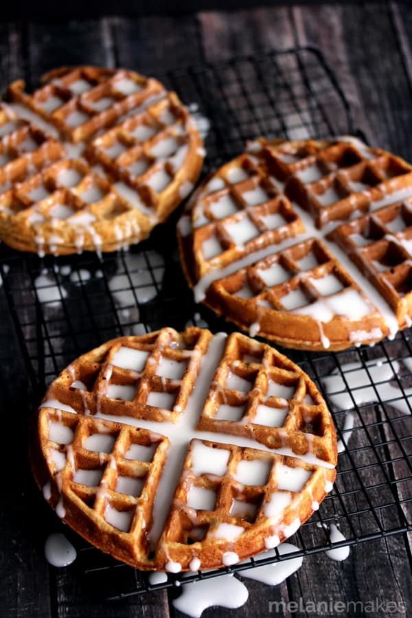 Whether you're serving them as a special holiday breakfast or giving them as a one of a kind homemade gift, these Gingerbread Yogurt Waffles with Powdered Sugar Glaze are a memorable treat.  Waffles spiked with the warming holiday flavors of cinnamon and ginger emerge from a waffle iron and then are doused in a stream of white powdered sugar glaze.