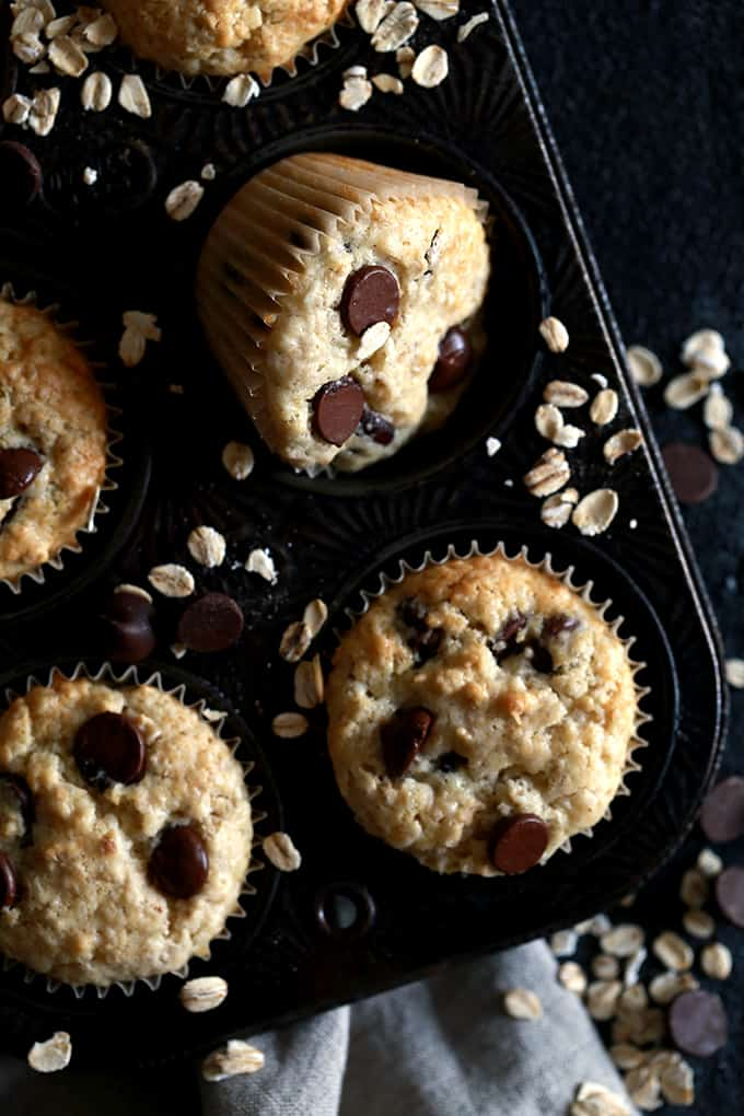 An overhead shot of Oatmeal Chocolate Chip Muffins in a muffin pan.