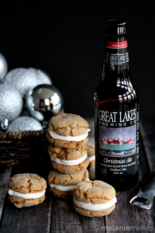 These Ginger Cookie Sandwiches with Christmas Ale Buttercream are the standout star of your Christmas cookie exchange.   All of the spices of the holiday season in a soft and chewy cookie sandwich with a whipped buttercream filling between.