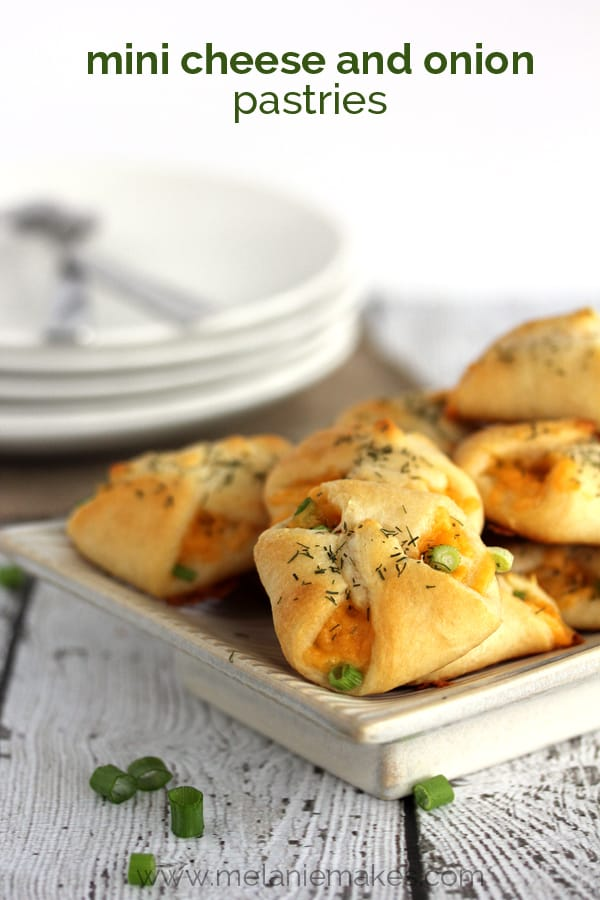 Sharp cheddar cheese and sliced green onion are gathered in the center of a dill dusted flaky pastry bundle. These Mini Cheese and Onion Pastries take only four ingredients and 15 minutes to prepare, a definite no-fuss appetizer or snack.