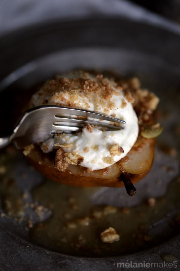 These Granola Streusel Baked Pears couldn't be easier to make and make a great breakfast treat or even a fabulous - almost healthy! - dessert. Gorgeous D'Anjou pears are stuffed with a delicious cinnamon granola streusel and baked in an apple juice bath until fork tender. A dollop of Greek yogurt is placed on top before being sprinkled with yet more struesel.