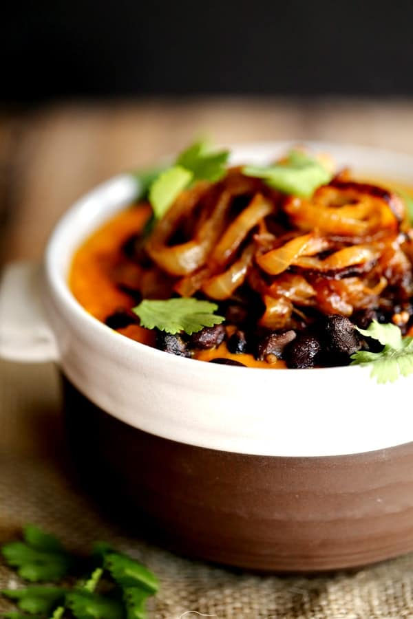 This velvety Southwest Carrot and Black Bean Soup is both hearty and satisfying and you won't want to share a single spoonful. Roasted carrots are pureed and studded with spiced black beans before being crowned with a generous tangle of fried onions and fresh cilantro.