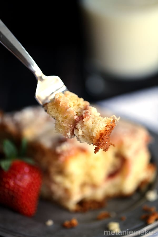 A thick swirl of cream cheese and strawberry jam is sandwiched between two layers of light as air coffee cake. This breakfast treat is then topped with a sugar and butter topping before being baked and then drizzled with a powdered sugar glaze. This Strawberries and Cream Coffee Cake will have your family rolling out of their beds and making a beeline for the kitchen in record time.