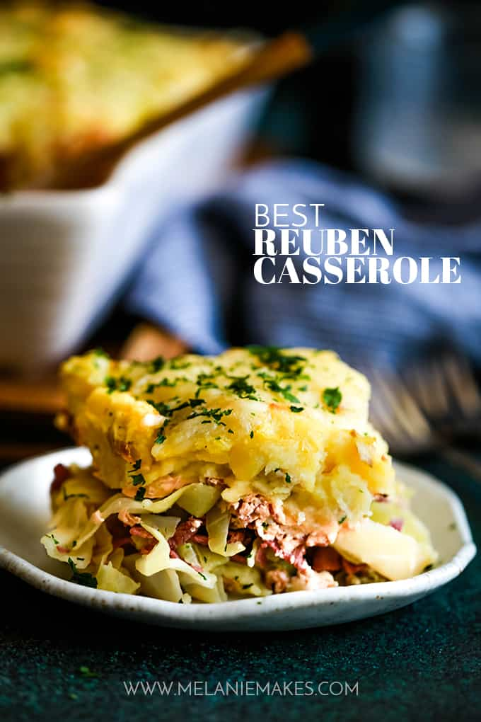 A slice of the Best Reuben Casserole sits on a white plate.