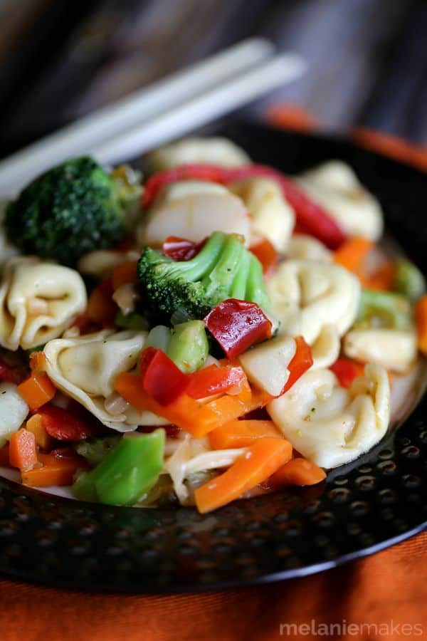 Taking shortcuts in the kitchen doesn't have to mean a boring meal!  This four ingredient Pepper and Garlic Tortellini Stir Fry comes together in just 20 minutes and is guaranteed to make hungry bellies happy.