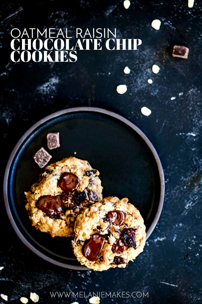 Two Oatmeal Raising Chocolate Chip Cookies on a black plate.
