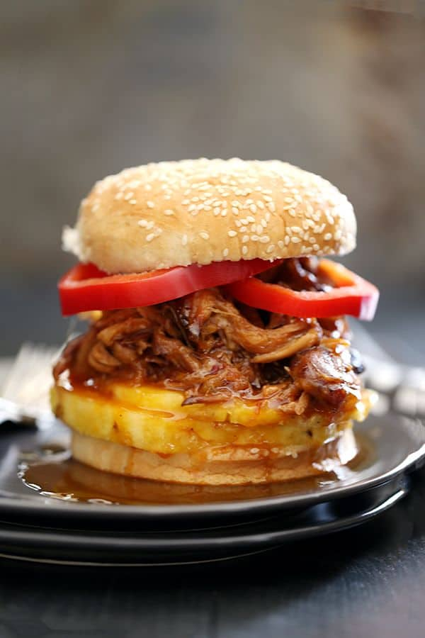 It takes just five minutes and three ingredients to create this sweet and spicy Pineapple and Habanero Slow Cooker Pulled Pork. It's then piled high on a toasted bun and sandwiched between slices of red pepper and fresh pineapple to create the messiest, most delicious pork sandwich that has ever met your lips.