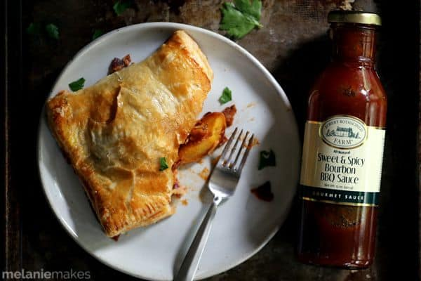 These Barbecue Bacon Peach Chicken Turnovers are full of flavor, yet easy enough for any weeknight. Flaky pillows of puff pastry are stuffed with chicken, bacon, cheddar and roasted peaches that are stirred together with a bourbon barbecue sauce.