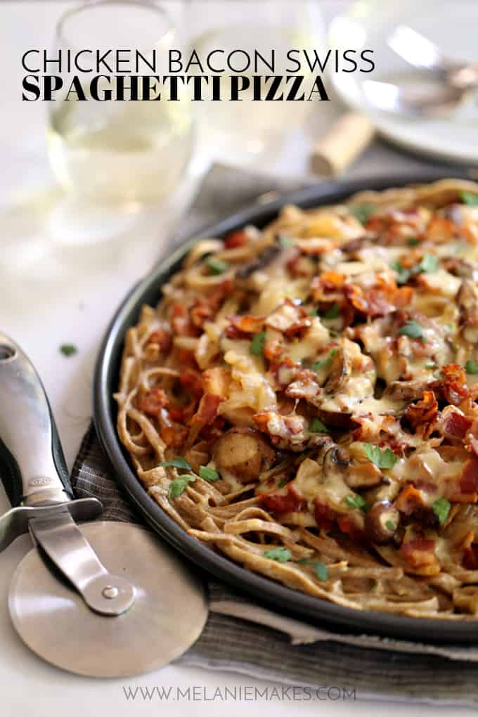 This Chicken Bacon Swiss Spaghetti Pizza is perfect for a night in or a night with friends.  A pasta crust spiked with Swiss cheese is the base of this masterpiece. Topped with bacon, chicken, mushrooms and onions which have all been cooked in rendered bacon fat, the entire pie is sprinkled with a generous amount of even more Swiss cheese.