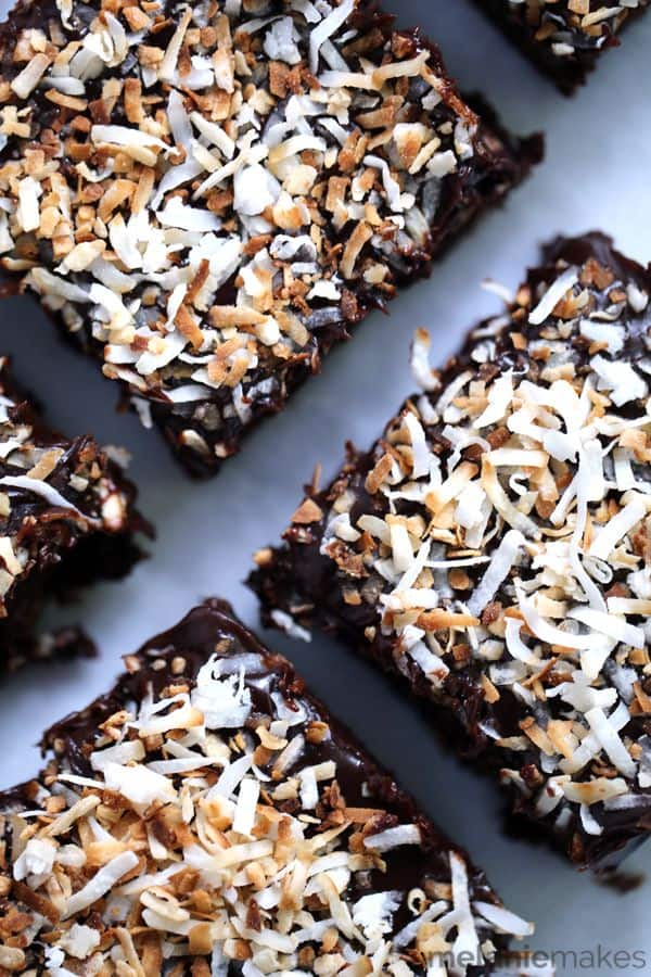 These one bowl chewy, Dark Chocolate Coconut Brownies are the perfect indulgent treat.  Spiked with coconut extract and spread with a thick layer of chocolate ganache, they're then sprinkled with toasted coconut for the perfect finishing touch.  Pour yourself a tall glass of milk, these brownies call for nothing less!