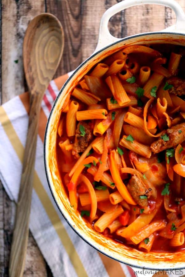 Italian sausage and slices of sweet pepper and onions mingle with pasta in a deliciously simple, warm and earthy red sauce. This One Pot Sausage and Peppers Pasta is a no-fuss meal that is on the table in 40 minutes with minimal clean-up required afterwards.