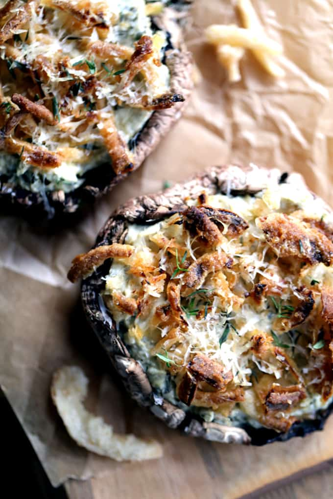 These five ingredient Artichoke and Spinach Stuffed Portobellos take just 10 minutes to prepare.  Meaty portobello mushroom caps are stuffed with artichoke spinach dip before being topped with french fried onions, fresh thyme and Parmesan cheese.