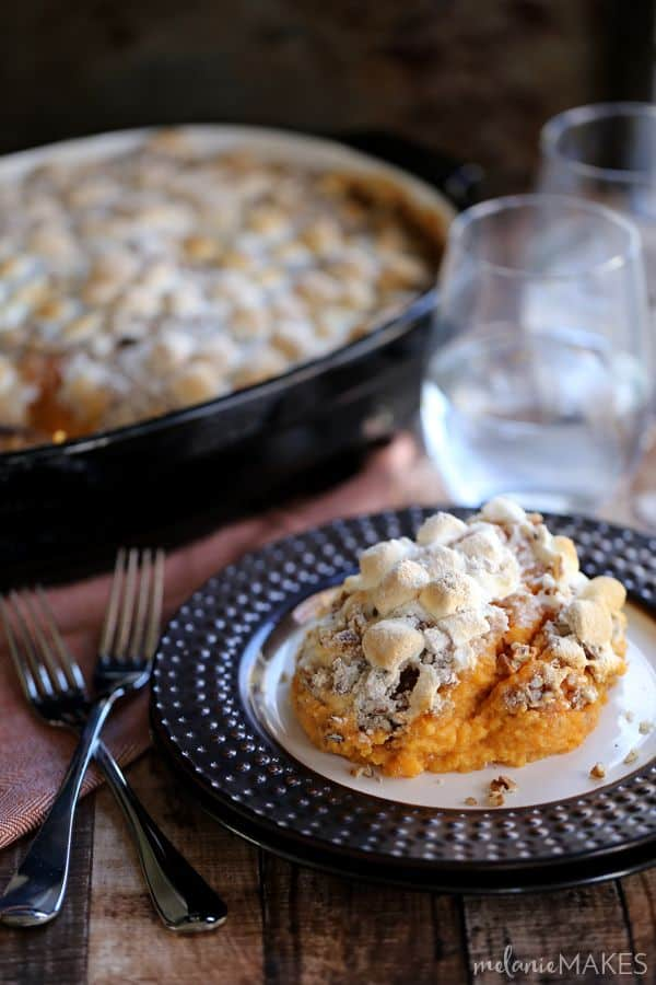This Make Ahead Sweet Potato Casserole is a holiday side dish must! Thanksgiving staple sweet potatoes take a swim with half and half, vanilla and brown sugar before being mashed together. They're then topped with a marshmallow - because they're required! - and pecan streusel before being baked to perfection.