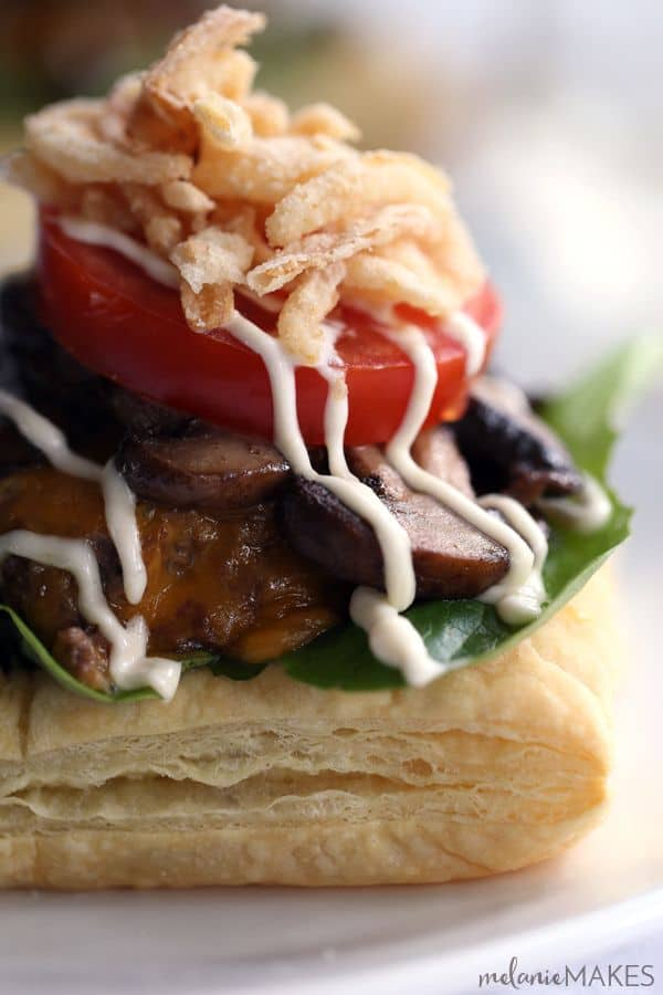 Sure, these Beef Wellington Burgers aren't meant to be handheld but they do welcome a side of fries with open arms! A puff pastry square is layered with salad greens and cheeseburger spiked with horseradish and Dijon mustard before being topped with mushrooms, tomato, french fried onions and a horseradish Dijion mayonnaise.