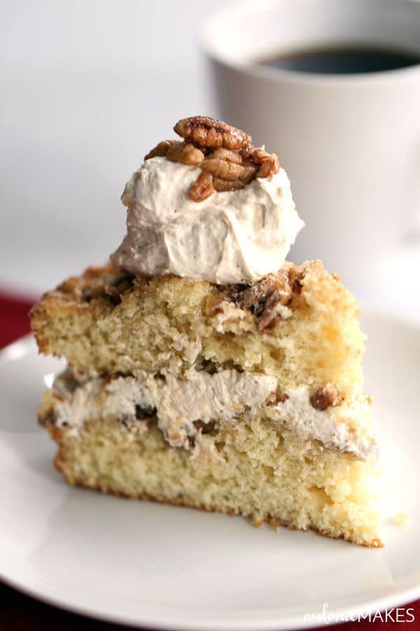 This Candied Pecan Sour Cream Coffee Cake with Eggnog Cream Filling is the perfect make ahead recipe for a holiday breakfast or brunch. A cinnamon spiked eggnog cream filling is sandwiched between two layers of sour cream coffee cake, studded with candied pecans.