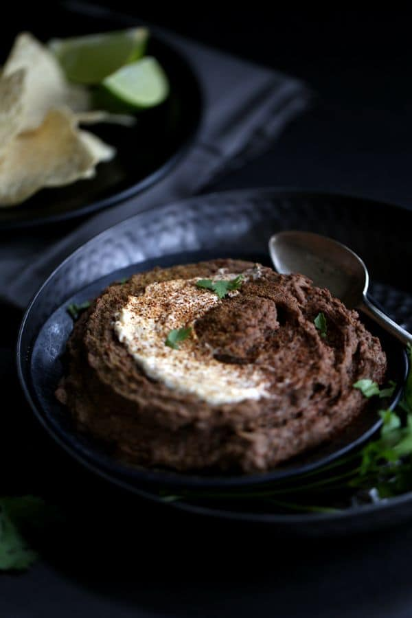 The award for easiest appetizer goes to this Sweet and Spicy Black Bean Hummus. Bid farewell to chickpeas as this hummus gets it's gorgeous earthy color and flavor from pantry staple black beans. All of the ingredients take a whirl in a the bowl of a food processor and emerge as a smooth and creamy hummus ready to enjoy in just 10 minutes.