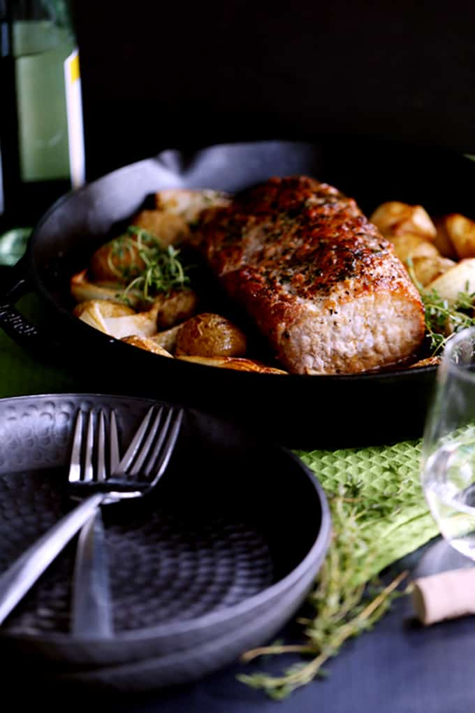This Thyme Crusted Pork Roast with Soy Caramel Sauce is dressed to impress!  A crust of pepper, salt and thyme envelopes the pork that is then roasted alongside baby Yukon Gold potatoes and onion wedges.  A waterfall of soy caramel sauce is then poured over everything before it's returned to the oven to finish roasting.