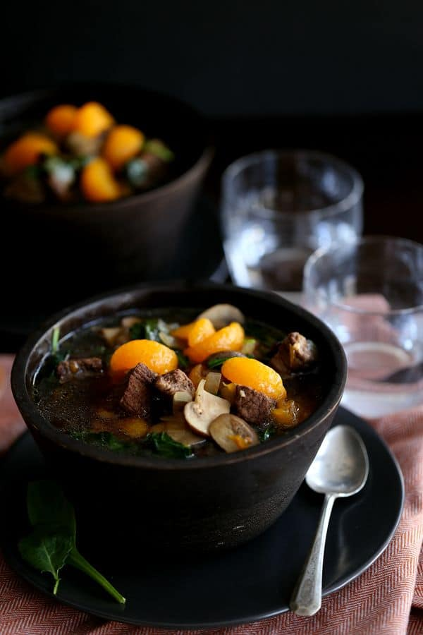 Pieces of beef stew meat mingle together with baby portabellas, mandarin oranges and baby kale to create this Orange Beef Teriyaki Soup that is absolutely packed with flavor. It's like your favorite Chinese take-out meal in soup form!