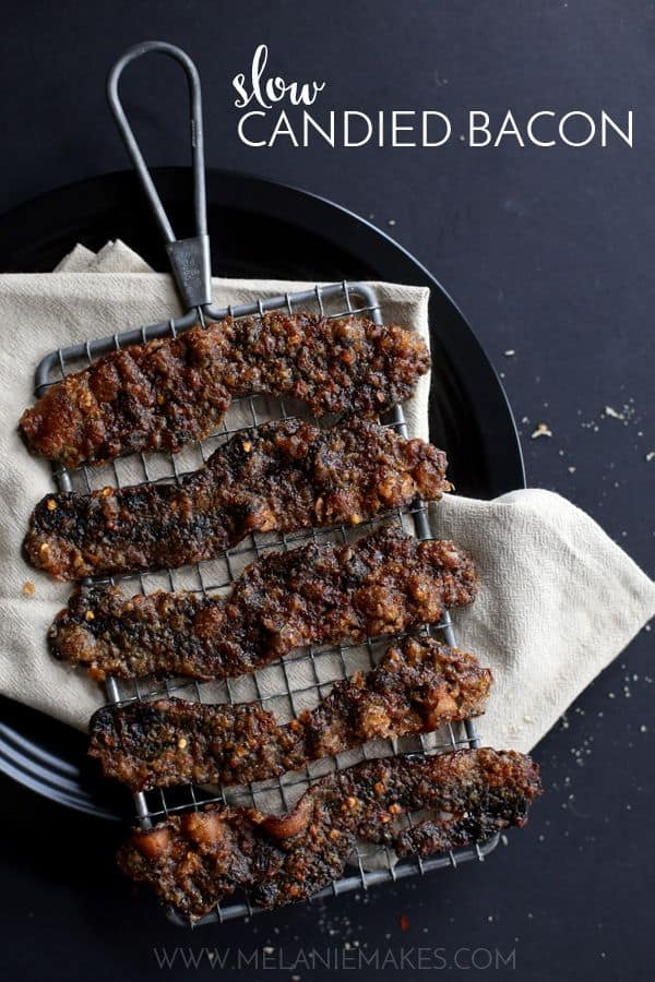 Thick-cut bacon is spread with brown sugar, red pepper flakes and ground mace before taking a long sauna in a low temperature oven. The sticky, spicy, sweet slices of Slow Candied Bacon that emerge are nothing short of addicting.