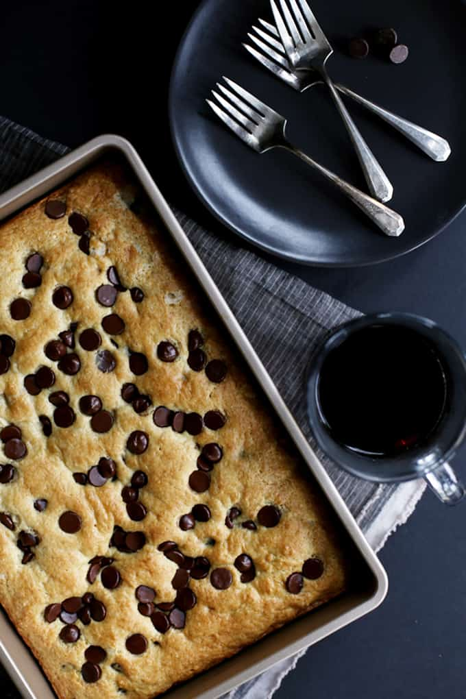 This one bowl Chocolate Chip Sour Cream Coffee Cake takes just 10 minutes to prepare and you likely have all the ingredients in your fridge or pantry already.  A light and fluffy sour cream coffee cake is studded with not one but two cups of dark chocolate chips to create the perfect breakfast or brunch dish to begin your day.
