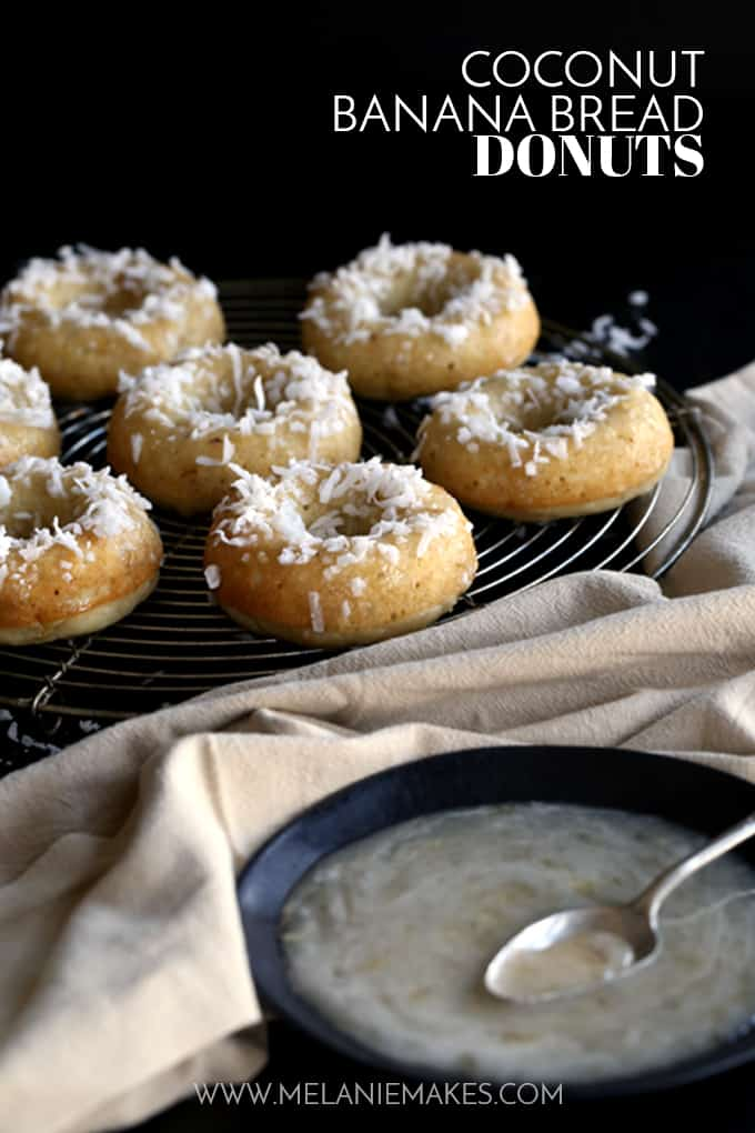 These Coconut Banana Bread Donuts are destined to transport you to your happy place without getting up from your breakfast table. A banana bread batter spiked with coconut is baked to donut perfection before being drizzled with a banana glaze and sprinkled with additional coconut.