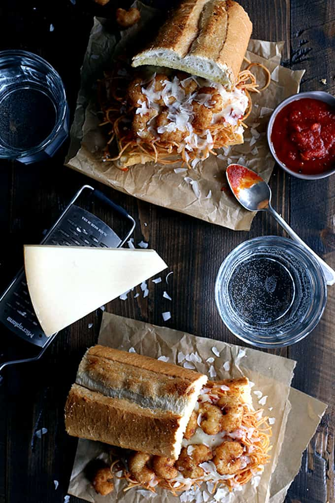 These six ingredient Shrimp Parmesan Sandwiches take just 10 minutes to prepare.  Spaghetti with marinara sauce, popcorn shrimp and mozzarella and Parmesan cheese are sandwiched between two pieces of crusty garlic bread - the perfect meatless meal during Lent!